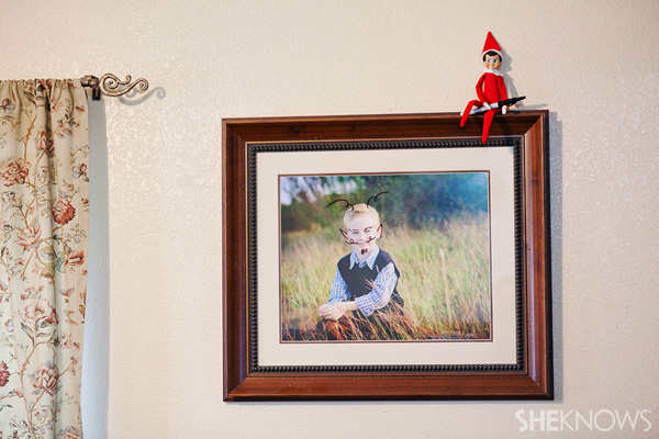 Elf on the Shelf idea 19: Elfie Rojo doodles on a photo