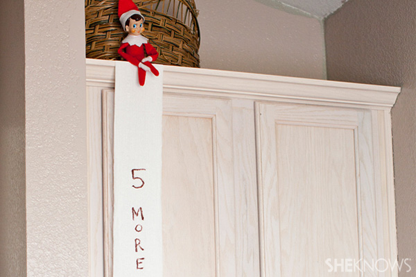 Elf on the Shelf idea 13: Elfie Rojo plays with toilet paper
