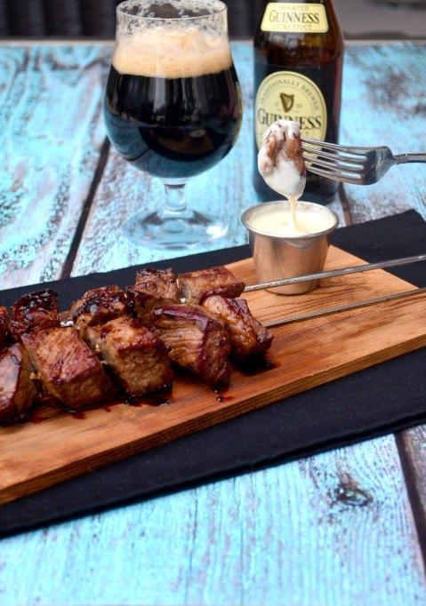 Guinness steak skewers with gouda and beer on side