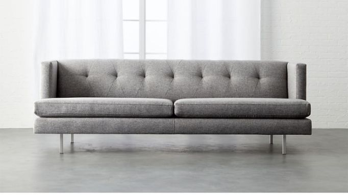 CB2 avec grey sofa with brushed stainless steel legs