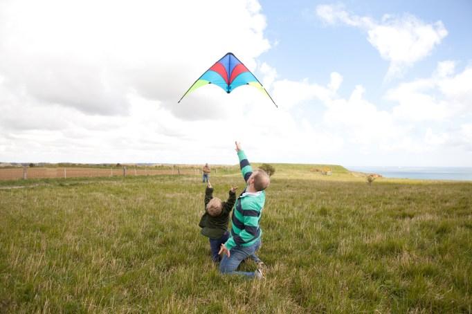 Man and boy flying kite