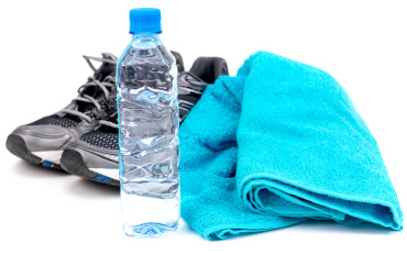 Fitness shoes, water, and towel | Sheknows.ca