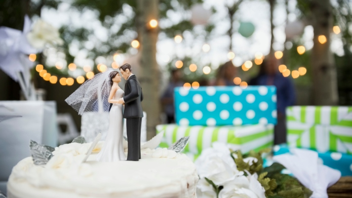 Bride and groom cake topper on
