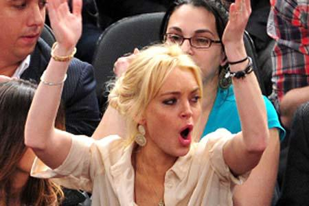 Lindsay Lohan parties her troubles away