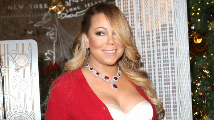 Mariah Carey Writhes Around in Leather