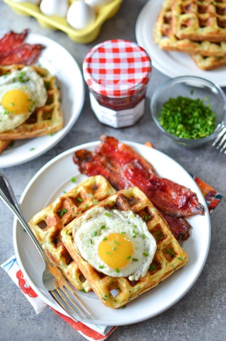 11 Sweet and Savory Waffle Recipes: Sweet and savory bacon is utterly snackable when candied in strawberry jam.