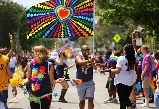 The annual Pride Parade makes its way along Beacon Street in Boston