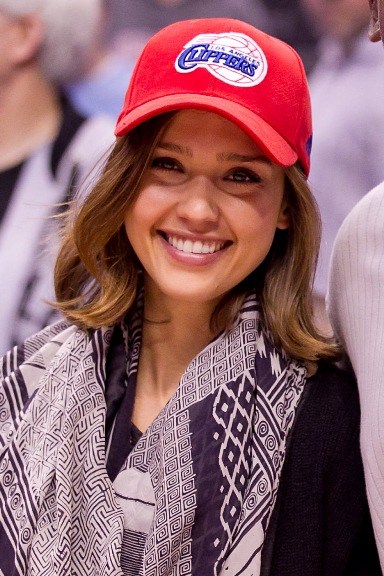 Jessica Alba with baseball cap hair accessory in summertime