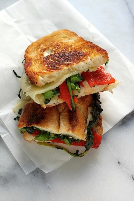 Summer sandwich recipe: broccoli rabe and roasted red peppers spice up a grilled cheese sandwich.