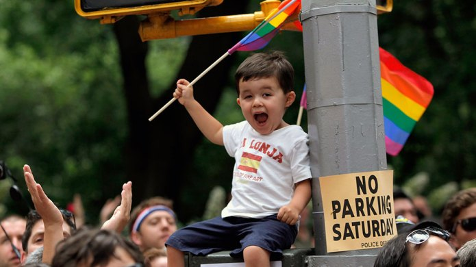 Young boy waves a flag during
