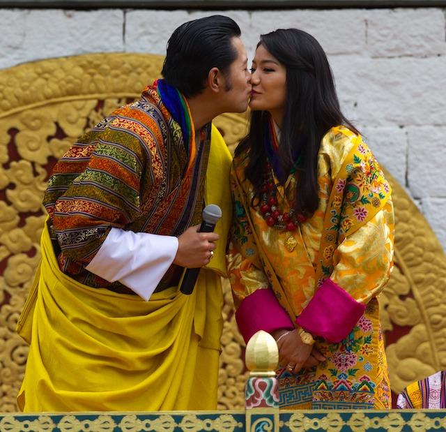 King Jigme Khesar Namgyel Wangchuck & Queen of Bhutan Ashi Jetsun kiss on their wedding day