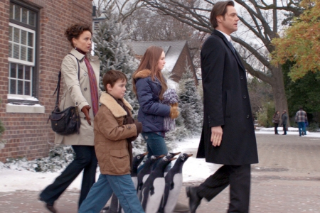 Carla Gugino and Jim Carrey in Mr. Popper's Penguins