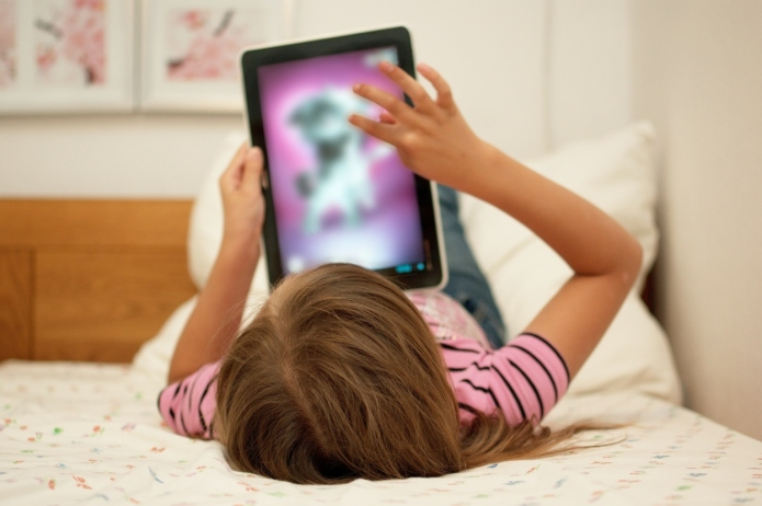 Little girl uses mom's iPad to