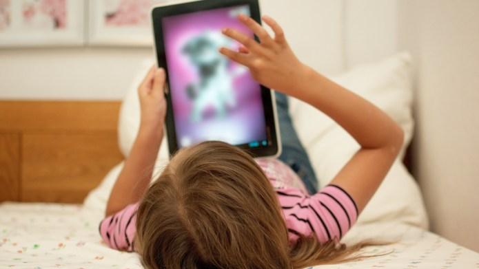 Little girl uses mom's iPad to