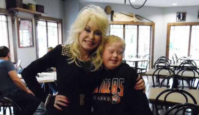 Dolly Parton with a fan