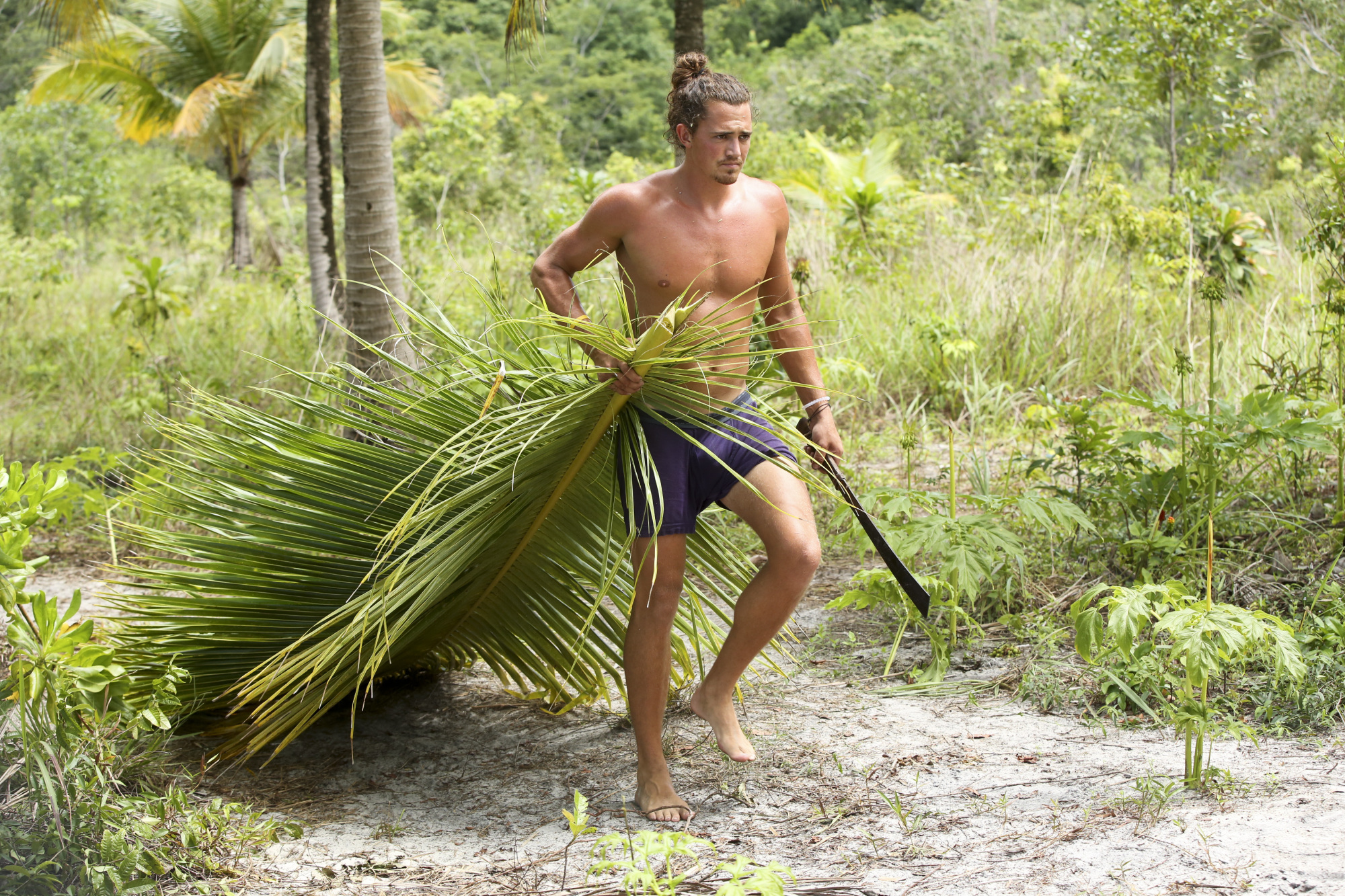 Joe Anglim works at camp on Survivor: Second Chance