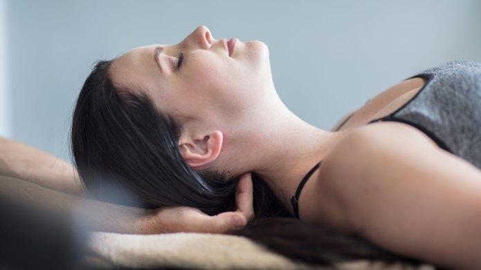 Woman receiving massage after workout