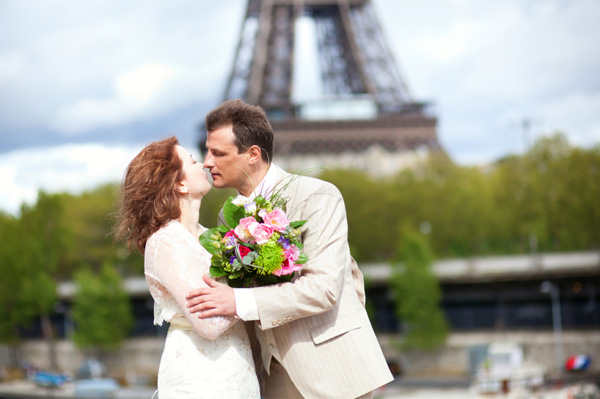 Just married couple kissing in Paris