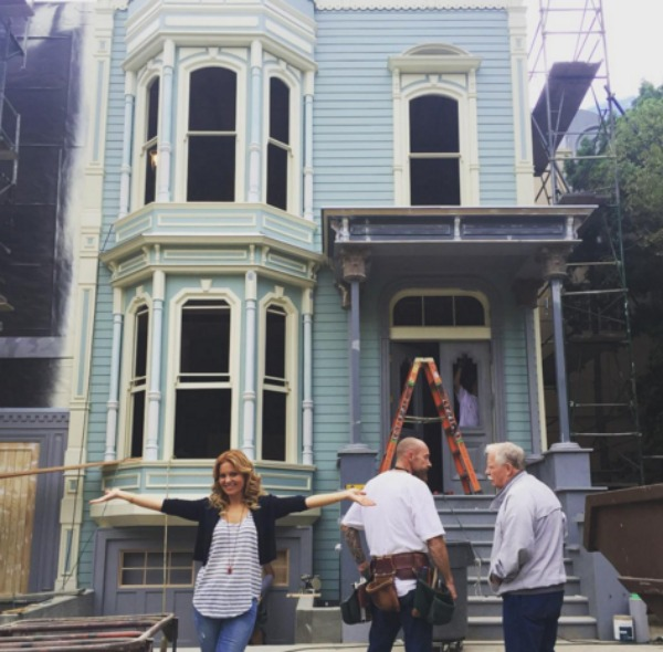 Candace Cameron Bure in front of the Full House house