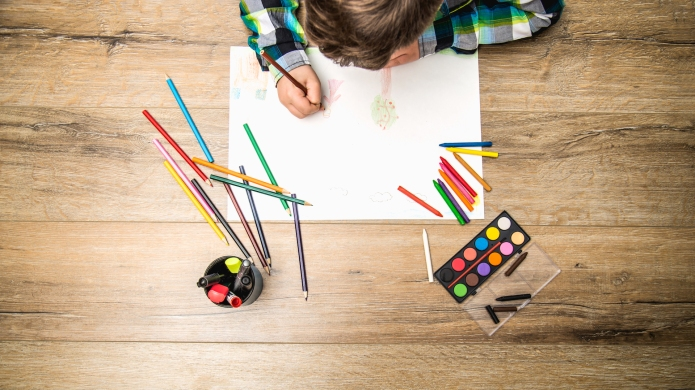 close up of boy drawing with