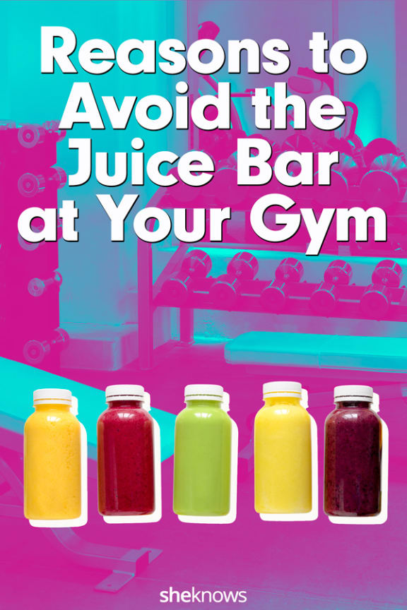 Colorful bottles of juice on gym background