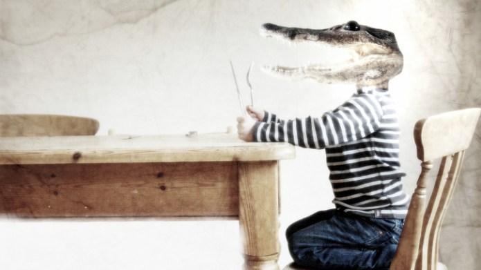 A boy with an alligator's head
