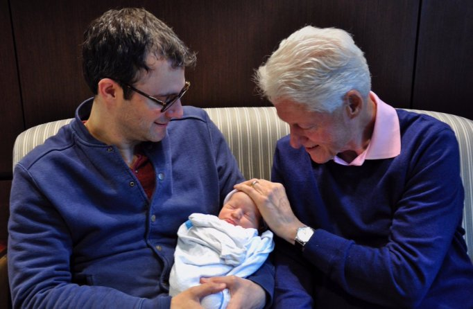 Funniest Bill Clinton photos: Bill Clinton with his newborn grandson