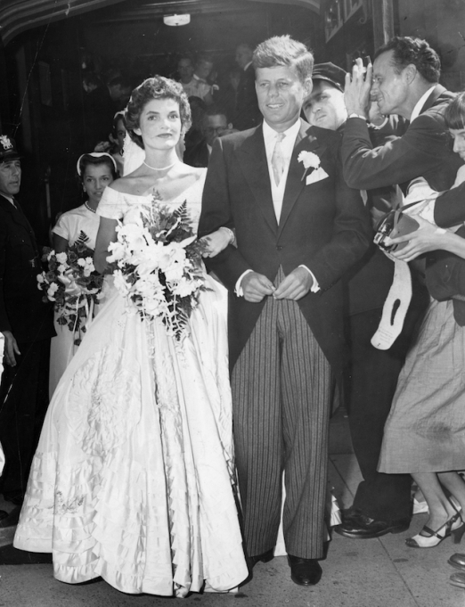 Jackie Kennedy and John F. Kennedy walk out of St. Mary's Church in Newport, R.I. after their wedding ceremony