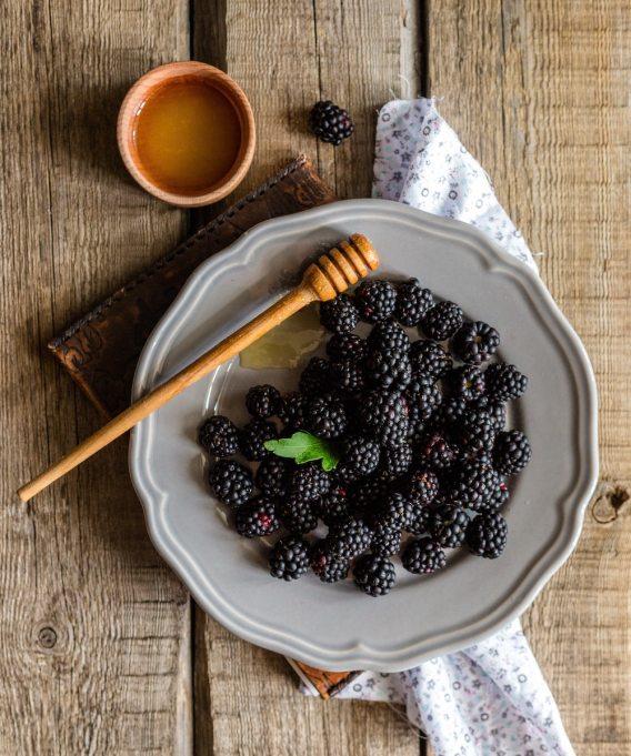 blackberries honey wooden table