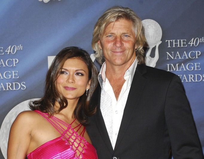 Nia Peeples and her husband Same George on a red carpet