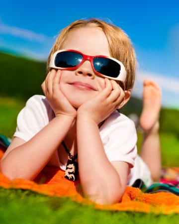 Kid wearing sunglasses