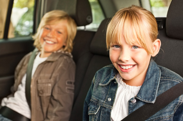 older kids in car