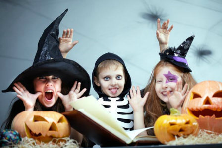 Kids reading Halloween book