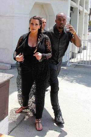 Kim Kardashian and Kanye West all in black