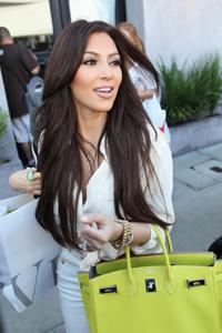Kim kardashian old navy look alike dating reggie bush