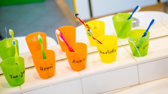 Plastic cups with toothbrushes with manes
