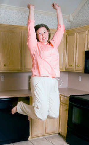 Woman Exercising in Kitchen