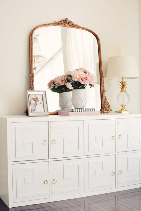 Ikea Kallax Hacks: Kallax units transform into a glam storage unit with an ornate mirror on top