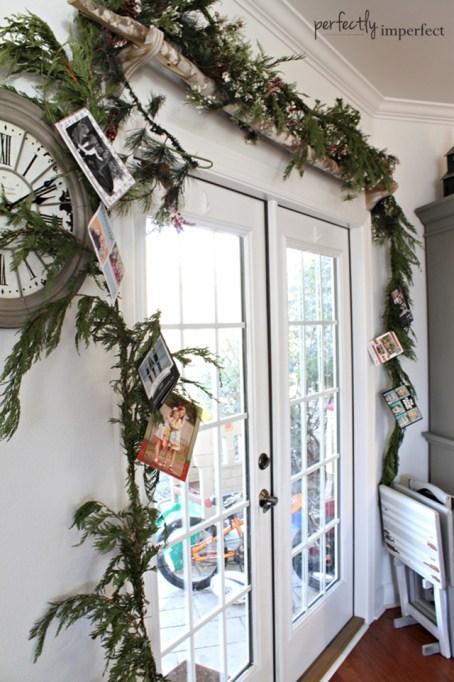 holiday card display on garland around door