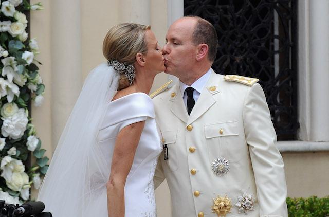 Princess Charlene of Monaco & Prince Albert II of Monaco kiss on their wedding day