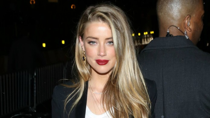 Apparently, spies are watching Amber Heard