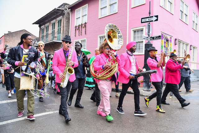 Members of Preservation Hall Jazz Band, Arcade Fire and RAM of Haiti parades through the French Quarter