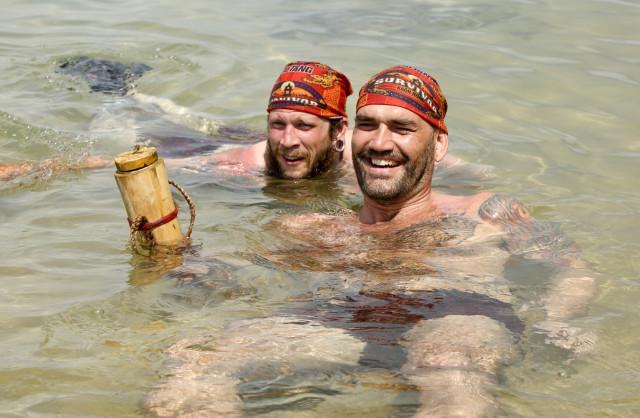 Kyle Jason and Scot Pollard swim at Brawn tribe's beach on Survivor: Kaoh Rong