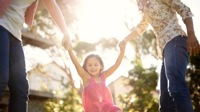 A cute little girl being swung
