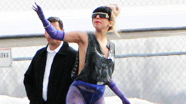 Lady Gaga with black bangs and a hugh bun hairstyle