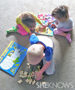 Laura Crawford's kids doing puzzles