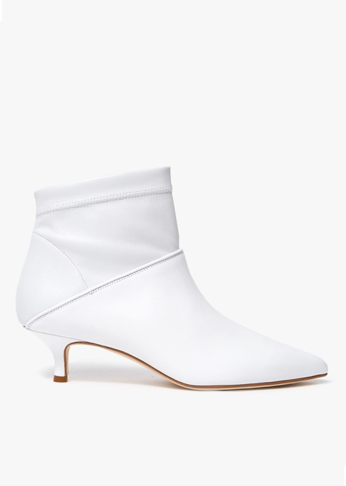 Fall Boots To Shop Before They Sell Out: Tibi Bright White Jean Boots | Fall Fashion Trends 2017