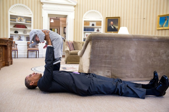 Obama with little baby on the floor