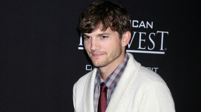 Ashton Kutcher kissed another woman twice