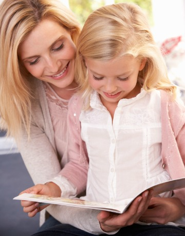 Mom teaching daughter to read